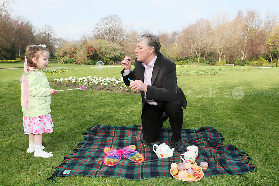 NO REPRO FEE. 27/3/2011.  Tea Day Appeal. Pat Kenny enjoys a cup of tea with Molly Ward aged 4 to launch the 17th Annual Alzheimer Society of Ireland Tea Day Appeal at the Merion Square Park Dublin. Alzheimer's Tea Day takes place nationally on Thursday 5 May to raise funds to help The Society provide local dementia services throughout Ireland. Individuals, groups and businesses are urged to participate and make 5 May 2011 'A Day to Remember'. To register for Tea Day 2011 or make a donation phone 1 800 719 820 or visit www.teaday.ie  To contact the Alzheimer's Helpline in confidence phone 1800 341 341 weekdays 10 am to 4 pm.. Picture James Horan/Collins