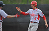 Alec Maag #6, Center Moriches catcher, right, gets congratulated by teammate David Franchi #7 after crossing home plate on a three-run double by David Falco #11 (not pictured) in the top of the sixth inning of a Suffolk County varsity baseball game against host Babylon High School on Monday, April 17, 2017. Center Moriches won by a score of 3-1.