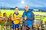 Beaufort Sarah Houlihan accepts the Kerry LGFA Intermediate Cup from County sec Donal Rahilly after their win against Chorca Dhuibhne on Saturday night in Austin Stack Park.
