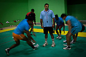 Bhaskar Ran (centre), coach of the Indian Kabbadi team poses for a portrait while his team trains at a month long camp in Sport Authority of India Sports Complex in Bisankhedi, outskirts of Bhopal, Madhya Pradesh, India. Photo: Sanjit Das