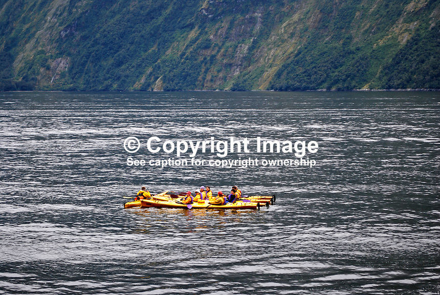 Flotilla of canoes in Milford Sound, New Zealand's top tourist destination. It was described by Rudyard Kipling as the Eigth Wonder of the World. Geographically it is not a sound but a fijord. It is 15 kilometres long and its sheer rock interfaces rise to 1200 metres. 201004055023..© Victor Patterson, 54 Dorchester Park, Belfast, N Ireland. Tel: +44 2890661296; Mobile: +44 7802 353836; Emails: victorpatterson@me.com & victorpatterson@gmail.com; www.victorpatterson.com