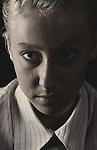 Close up of teenagers face staring at camera