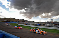 Nov. 9, 2008; Avondale, AZ, USA; NASCAR Sprint Cup Series driver Kyle Busch (18) during the Checker Auto Parts 500 at Phoenix International Raceway. Mandatory Credit: Mark J. Rebilas-