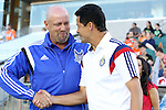 14 June 2014: Carolina head coach Colin Clarke (NIR) (left) and Chivas USA head coach Wilmer Cabrera (COL) (right) shake hands before the game. The Carolina RailHawks of the North American Soccer League played Chivas USA of Major League Soccer at WakeMed Stadium in Cary, North Carolina in the fourth round of the 2014 Lamar Hunt U.S. Open Cup soccer tournament. The RailHawks advanced by winning a penalty kick shootout 3-2 after the game had ended in a 1-1 tie after overtime.