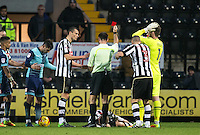 Michael O'Connor of Notts Co is given a red card as he lays injured during the Sky Bet League 2 match between Notts County and Wycombe Wanderers at Meadow Lane, Nottingham, England on 10 December 2016. Photo by Andy Rowland.