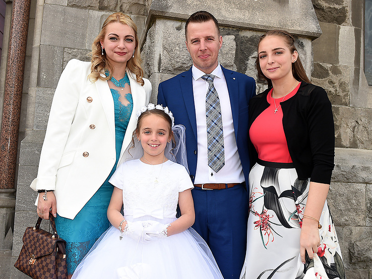 Sienna Kierans from St. Mary's school who received First Holy Communion in St. Mary's church pictures with parents Robbie and Julia and sister Marianna.  Photo:Colin Bell/pressphotos.ie