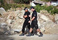 Pictured: Two forensics officers walk through the new site in Kos, Greece. Saturday 08 October 2016<br />Re: Police teams led by South Yorkshire Police, searching for missing toddler Ben Needham on the Greek island of Kos have moved to a new area in the field they are searching.<br />Ben, from Sheffield, was 21 months old when he disappeared on 24 July 1991 during a family holiday.<br />Digging has begun at a new site after a fresh line of inquiry suggested he could have been crushed by a digger.