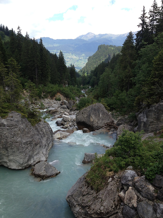 The lower sections of the climb to Grosse Scheidegg, near Meiringen, Switzerland, are steep, and follow a crystal blue stream.