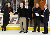 John Hegarty (BC - Dir-Hockey Operations), Jerry York (BC - Head Coach), Greg Brown (BC - Assistant Coach), Jim Logue (BC - Assistant Coach) and Mike Cavanaugh (BC - Associate Head Coach) wait for the band to finish playing the alma mater. - The Boston College Eagles defeated the University of Massachusetts-Amherst Minutemen 2-1 (OT) on Friday, February 26, 2010, at Conte Forum in Chestnut Hill, Massachusetts.
