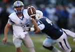 Air Force quarterback Karson Roberts watches the ball as he's hit by a Nevada defender during the first half of an NCAA football game in Reno, Nev., on Saturday, Sept. 28, 2013. <br /> Photo by Cathleen Allison
