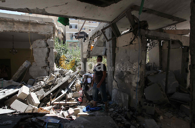 The debris of a house belonging to Ayyad Christian family, which witnesses said was targeted in an Israeli air strike, is seen in Gaza City July 27, 2014. Palestinian medics said at least 17 people had died in the wave of subsequent strikes that swept Gaza, including a Christian woman, Jalila Faraj Ayyad, whose house in Gaza City was struck by an Israeli bomb. Fighting subsided in Gaza on Sunday after Hamas Islamist militants said they backed a 24-hour humanitarian truce, but there was no sign of any comprehensive deal to end their conflict with Israel.. Photo by Ashraf Amra