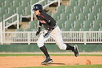 Trayce Thompson #24 of the Kannapolis Intimidators takes off for second base against the West Virginia Power at Fieldcrest Cannon Stadium April 25, 2010, in Kannapolis, North Carolina.  Photo by Brian Westerholt / Four Seam Images