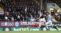 Burnley's Chris Wood steers his late effort on goal wide under pressure from Huddersfield Town's Eric Durm<br /> <br /> Photographer Rich Linley/CameraSport<br /> <br /> The Premier League - Burnley v Huddersfield Town - Saturday 6th October 2018 - Turf Moor - Burnley<br /> <br /> World Copyright &copy; 2018 CameraSport. All rights reserved. 43 Linden Ave. Countesthorpe. Leicester. England. LE8 5PG - Tel: +44 (0) 116 277 4147 - admin@camerasport.com - www.camerasport.com