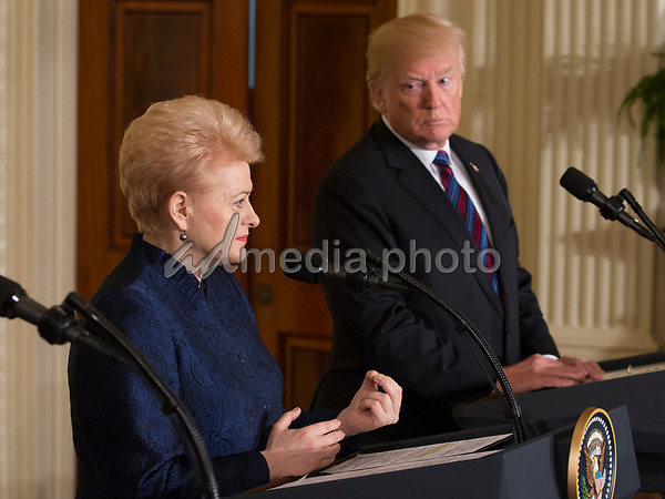 United States President Donald J. Trump participates in a news briefing with President Raimonds Vejonis of Latvia(L),  President Kersti Kaljulaid of Estonia(2nd L) and President Dalia Grybauskaite of Lithuania(2nd R) at The White House in Washington, DC, April 3, 2018. Photo Credit: Chris Kleponis/CNP/AdMedia