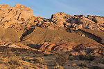 Tongues of the darker Carmel Formation mudstone protrude up like jagged teeth over the whiter Navajo Sandstone at the base of the San Rafael Reef in south central Utah.
