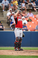 Carolina Mudcats catcher Tanner Murphy (15) warms up the pitcher in between innings during a game against the Frederick Keys on June 4, 2016 at Nymeo Field at Harry Grove Stadium in Frederick, Maryland.  Frederick defeated Carolina 5-4 in eleven innings.  (Mike Janes/Four Seam Images)
