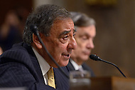 February 14, 2012  (Washington, DC)  Secretary of Defense, Leon Panetta (left) testifies before the Senate Armed Services Committee regarding the FY2013 defense budget. At right, Under Secretary of Defense (Comptroller) Robert Hale.   (Photo by Don Baxter/Media Images International)