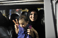 A woman smiles as she holds her daughter in a car, celebrating at Martyrs' Sqaure in Tripoli. After a six month revolution, rebel forces finally managed to break into Tripoli and have taken control of Bab al-Aziziyah, Col Gaddafi's compound and residence. Few remain that are loyal to Gaddafi in the city; it is seeming that the 42 year regime has come to an end. Gaddafi is currently on the run.