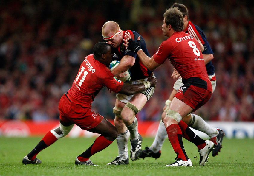 Photo: Richard Lane/Richard Lane Photography. .Munster v Toulouse. Heineken Cup Final. 24/05/2008. .Munster captain, Paul O'Connell is tackled by Toulouse's Yves Donguy and Shaun Sowerby.