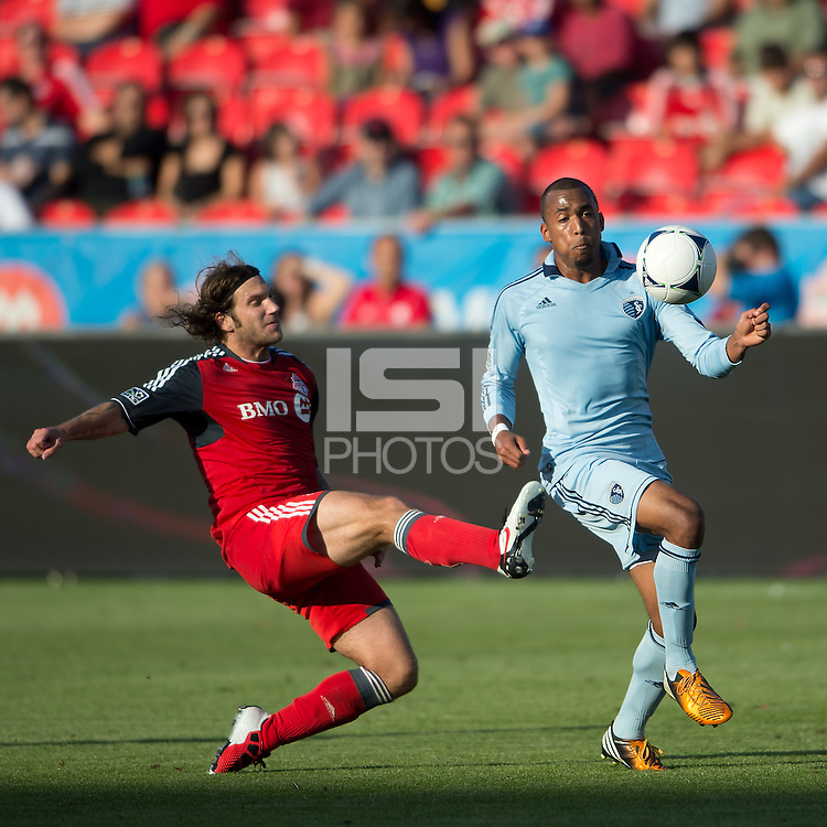 18 August 2012: Toronto FC midfielder Torsten Frings #22 and Sporting KC forward Teal Bunbury #9 in action during an MLS game between Sporting Kansas City and Toronto FC at BMO Field in Toronto, Ontario Canada..Sporting Kansas City won 1-0.