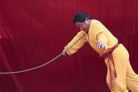 A Chinese martial arts master bends a iron rod by pressing it against his throat during a performance at a temple fair on February 19, 2010 in Beijing, China. Chinese continue to celebrate the Lunar Chinese New Year of the Tiger by visiting temple fair to watch traditional folk performances and eat local delicatessens.