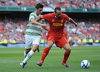 10th August 2013; Jose Enrique, Liverpool, in action against Bahrudin Atajic, Glasgow Celtic. Pre-season Friendly, Liverpool v Celtic, Dublin Decider, Aviva Stadium, Dublin. Picture credit: Tommy Grealy/actionshots.ie.