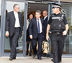Duff and Phelps Administrators David Whitehouse and Paul Clark leave Ibrox with a police guard after selling the club to Charles Green's consortium of investors