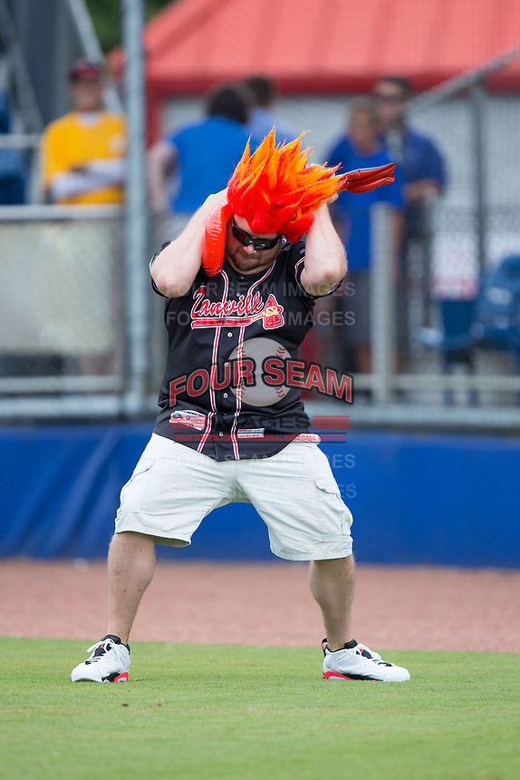 A fan competes in an air guitar contest between innings of the Appalachian League game between the Princeton Rays and the Danville Braves at American Legion Post 325 Field on June 25, 2017 in Danville, Virginia.  The Braves walked-off the Rays 7-6 in 11 innings.  (Brian Westerholt/Four Seam Images)