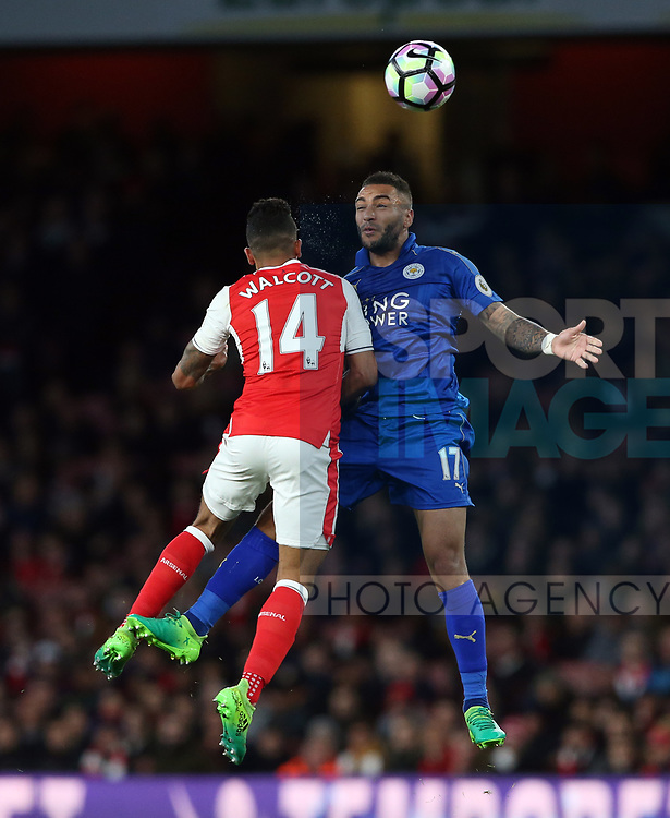 Arsenal's Theo Walcott tussles with Leicester's Danny Simpson during the Premier League match at the Emirates Stadium, London. Picture date: April 26th, 2017. Pic credit should read: David Klein/Sportimage