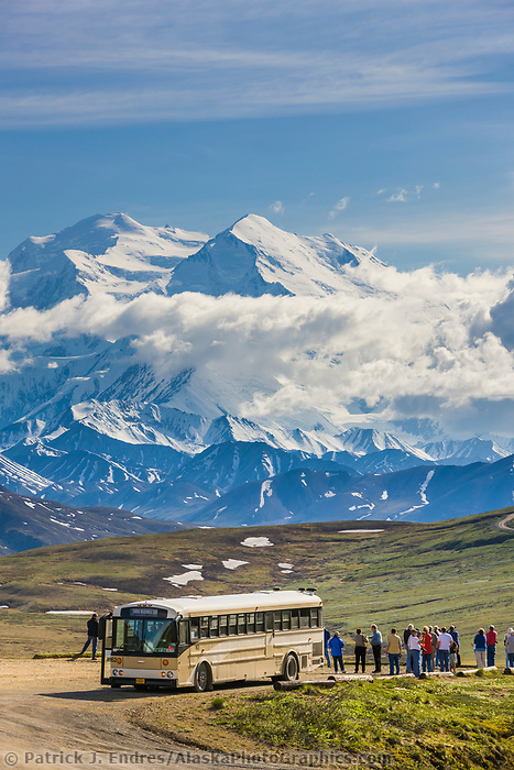 Tourists view the summit of Mt Denali, North america's highest peak, from Stoney Dome lookout in Denali National Park, interior, Alaska.