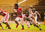 Inglewood, CA 10/09/14 - Christian Williams (Morningside #22) and Michael Joncich (Peninsula #4) in action during the Palos Verdes Peninsula vs Morningside CIF Varsity football game at Coleman Field in Inglewood.  Peninsula defeated Morningside 24-13.