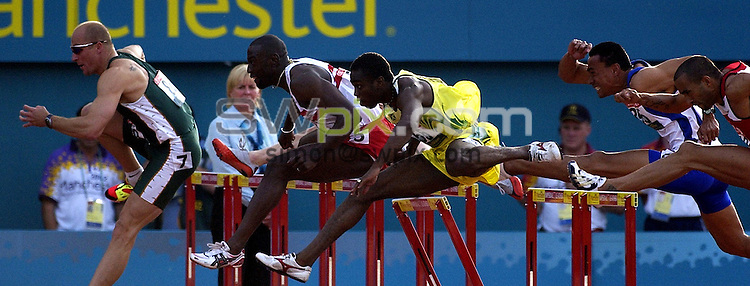 Pix:Ben Duffy/SWpix.com. Commonwealth Games. Manchester 2002.....hurdles..30/07/2002...COPYWRIGHT PICTURE>>SIMONWILKINSON>>01943 436649>>..mens 110m hurdles heat top snap