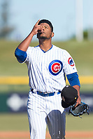 Mesa Solar Sox relief pitcher Manuel Rondon (51), of the Chicago Cubs organization, points to the sky as he walks off the field between innings of an Arizona Fall League game against the Surprise Saguaros at Sloan Park on November 15, 2018 in Mesa, Arizona. Mesa defeated Surprise 11-10. (Zachary Lucy/Four Seam Images)