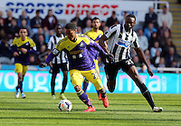 Pictured L-R: Jonathan de Guzman of Swansea against Shola Ameobi of Newcastle. Saturday 19 April 2014<br />