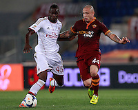 Calcio, Serie A: Roma vs Milan. Roma, stadio Olimpico, 25 aprile 2014.<br /> AC Milan forward Mario Balotelli, left, is challenged by AS Roma midfielder Radja Nainggolan, of Belgium, during the Italian Serie A football match between AS Roma and AC Milan at Rome's Olympic stadium, 25 April 2014.<br /> UPDATE IMAGES PRESS/Isabella Bonotto
