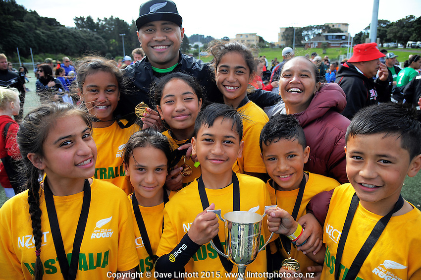 Rippa project manager Nuia Finau with the winning team, Roscommon School (Australia) at the end of day two of the 2015 Rippa Rugby World Cup Tournament at Wakefield Park, Wellington, New Zealand on Tuesday, 15 September 2015. Photo: Dave Lintott / lintottphoto.co.nz