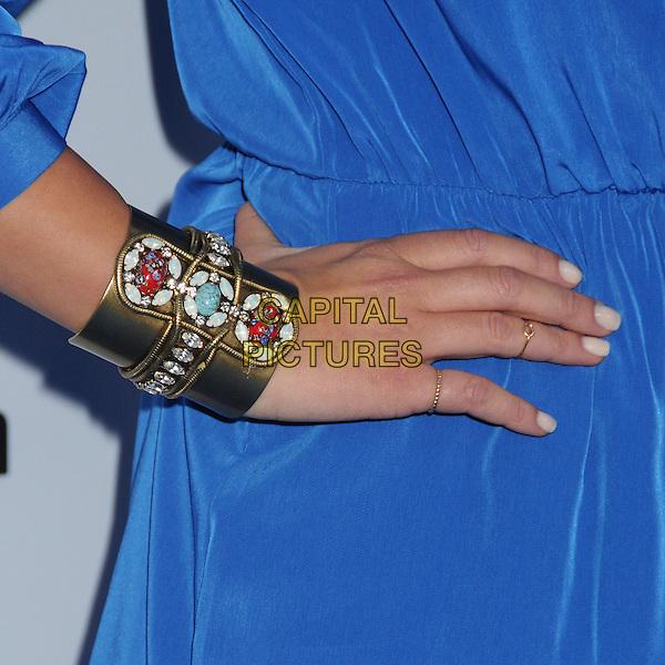 Chloe Bennet's hand.Disney Media Networks International Upfronts 2013 held at Walt Disney Studios, Burbank, California, USA..May 19th, 2013.on hip blue detail bracelet cuff gold beads beaded stones jewellery jewelry.CAP/ADM/BP.©Byron Purvis/AdMedia/Capital Pictures