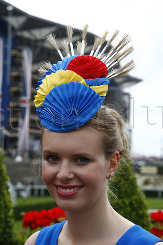 21.06.12 Ascot, Windsor, ENGLAND: Woman in a fancy hat and dress during Ladies Day Royal Ascot Festival at Ascot racecourse on June 21, 2012 in Ascot, England