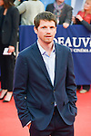 """Pierre Deladonchamp poses on the red carpet before the screening of the film """"The Man from U.N.C.L.E."""" during the 41st Deauville American Film Festival on September 11, 2015 in Deauville, France"""