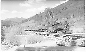RGS #20 with freight crossing Bridge 76-A over the Dolores River below Kings.<br /> RGS  Rio Lado, CO  Taken by Perry, Otto C. - 6/23/1944