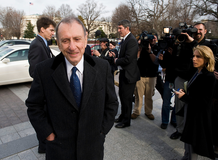 Sen. Arlen Specter, D-Pa., walks away from the media to find a ride to the White House after missing his ride with the rest of the Senate Democrats to lunch with President Obama to discuss the health care legislation on Tuesday, Dec. 15, 2009.