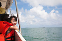 A happy girl (elementary age) enjoying a boat ride from Sandakan to Selingan Island (Turtle Island). Malaysia