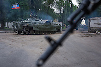 Russia-backed rebels miliaty convoy moves at the streets of Donetsk, Ukraine, Saturday, 30 May 2015