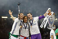 Calcio, Champions League: finale Juventus vs Real Madrid. Cardiff, Millennium Stadium, 3 giugno 2017.<br /> Real Madrid's Sergio Ramos, left, Luka Modric, center, and Gareth Bale take a selfie photo with the trophy at the end of the Champions League final match between Juventus and Real Madrid at Cardiff's Millennium Stadium, Wales, June 3, 2017. Real Madrid won 4-1.<br /> UPDATE IMAGES PRESS/Isabella Bonotto