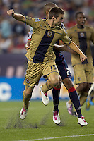 Second half substitute Philadelphia Union forward Jack McInerney (19) scores. The Philadelphia Union defeated New England Revolution, 2-1, at Gillette Stadium on August 28, 2010.