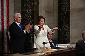 United States Vice President Mike Pence and Speaker of the United States House of Representatives Nancy Pelosi (Democrat of California) applaud as United States President Donald J. Trump finished delivering his second annual State of the Union Address to a joint session of the US Congress in the US Capitol in Washington, DC on Tuesday, February 5, 2019.<br /> Credit: Alex Edelman / CNP