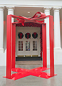 """The 2016 White House Christmas decorations are previewed for the press at the White House in Washington, DC on Tuesday, November 29, 2016. This is the """"gift"""" that is outside the East Visitor Entrance that is intended to be the background for photos.  The first lady's office released the following statement to describe those decorations, """"This year's holiday theme, 'The Gift of the Holidays,' reflects on not only the joy of giving and receiving, but also the true gifts of life, such as service, friends and family, education, and good health, as we celebrate the holiday season.""""<br /> Credit: Ron Sachs / CNP"""