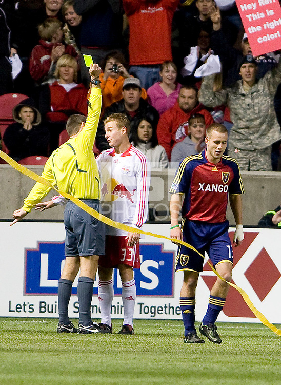Referee Terry Vaughn cautions New York Red Bulls defender Chris Leitch (33) during the Real Salt Lake vs New York Red Bulls 1-1 draw at Rio Tinto Stadium in Sandy, Utah. Photo by Eric Salsbery/isiphotos.com