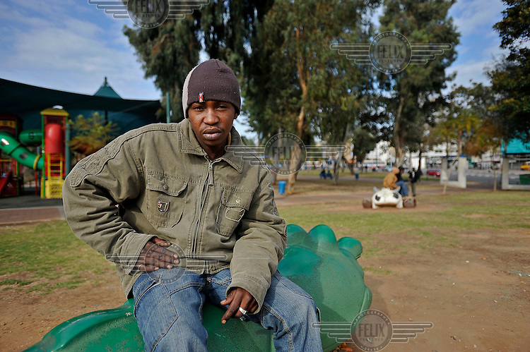 A Sudanese man, who illegally arrived in Israel in search of asylum three years earlier, hangs out at Levinsky Garden, a place that serves as a meeting place and as a pool of cheap workers.