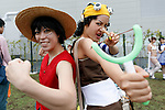 Cosplayers pose for a photograph during the first day of Comic Market 92 (Comiket) event at Tokyo Big Sight on August 11, 2017, Tokyo, Japan. The annual event that began in 1975 focuses on manga, anime, game and cosplay. Organizers expect more than 500,000 visitors to attend the 3-day event. (Photo by Rodrigo Reyes Marin/AFLO)